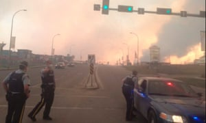 Alberta officers conduct search, rescue and evacuation efforts as they respond to wildfires in Fort McMurray, Alberta, Canada on Wednesday.