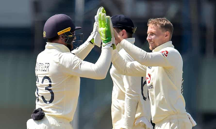 Joe Root celebrates with Jos Buttler after taking the wicket of Lasith Embuldeniya.
