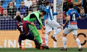 Espanyol's goalkeeper Diego López clashes with Levante's Armando Sadiku before going off injured.