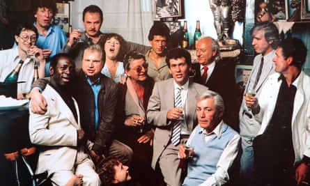 Colony Room Club members in the 1980s, including Michael Wojas, the club's third and final proprietor; Doctor Who actor Tom Baker; the artist Francis Bacon; and journalist Jeffrey Bernard.