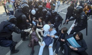 Riot police try to detain protesters during a rally in St Petersburg