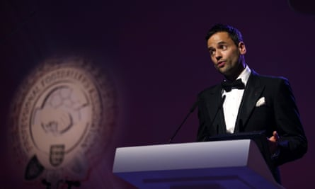 The PFA chairman Ben Purkiss speaks at an awards ceremony.
