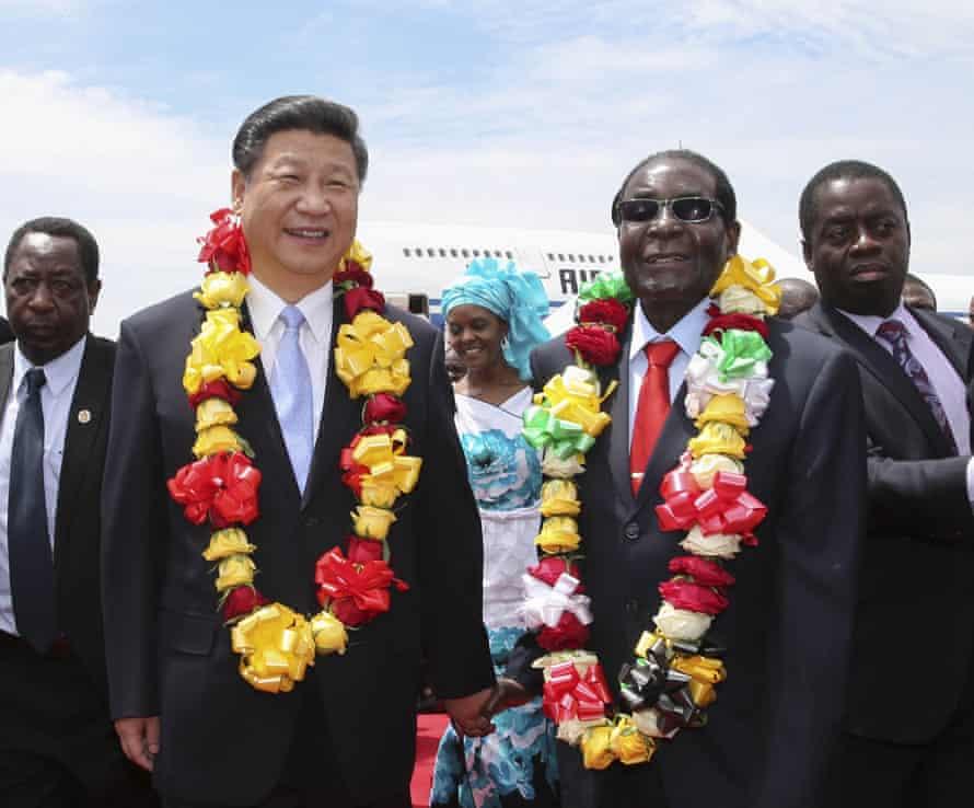 Xi hand in hand with Zimbabwean president Robert Mugabe.