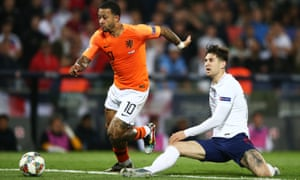 John Stones of England is dispossessed by Memphis Depay in teh lead up to the Netherlands' decisive second goal.