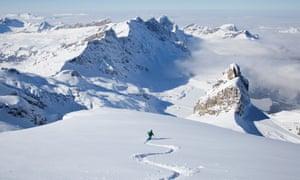 Off-piste skier in powder snow