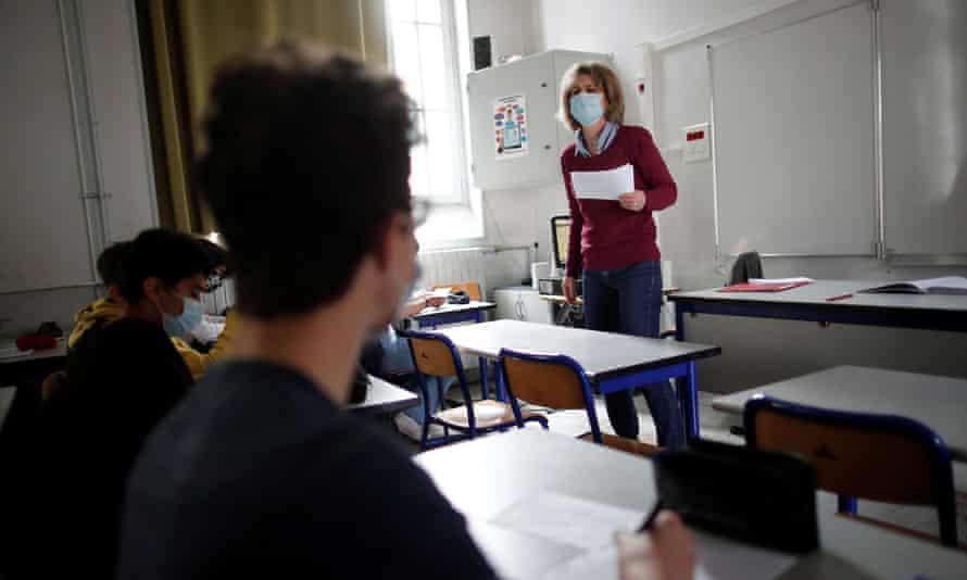A masked teacher in a classroom in Paris