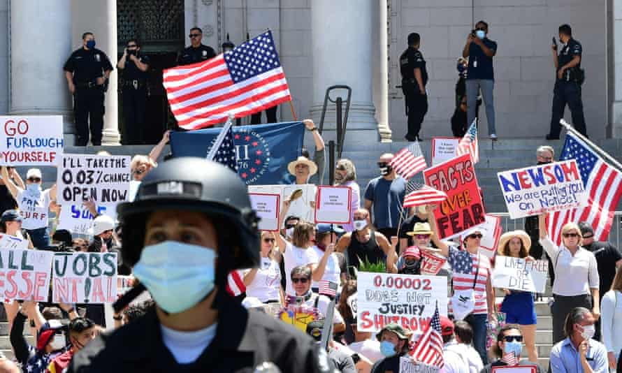 Demonstrators protest in front of Los Angeles City Hall last month to demand an end to California's shutdown.