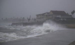 Waves pound the shore from the approaching Hurricane Harvey in Corpus Christi, Texas