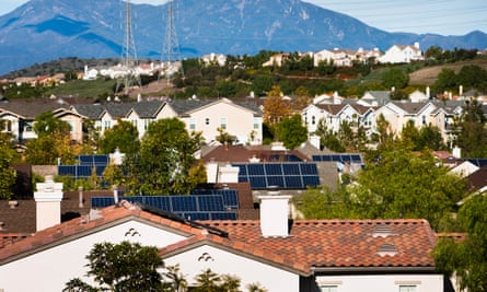 Rooftop view of houses with solar panels in a residential locality in California, US.