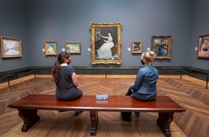 Visitors wearing PPE sit apart as they view Eva Gonzales, 1870, by Edouard Manet, at the National Portrait Gallery, London, as it prepares to reopen following the easing of coronavirus lockdown restrictions across England.