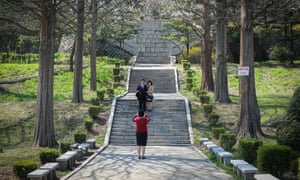 A woman takes a photo of a young couple in Moran Park, Pyongyang, North Korea.
