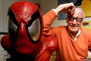 Stan Lee poses next to a Spider-Man model in his office in Beverly Hills, California, in December 2008