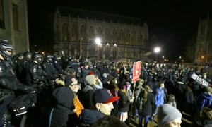Protesters and police gather as Milo Yiannopoulos gives a speech.