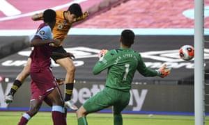 Wolverhampton Wanderers' Raul Jimenez heads the ball to open the scoring.