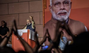 Narendra Modi speaks to party workers at the BJP headquarters after the party's landslide victory
