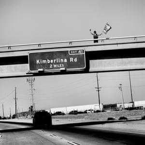 USA. Bakersfield, California. 2020. Trump supporter on an overpass.