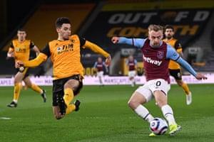 West Ham United's English striker Jarrod Bowen (R) shoots past Wolverhampton Wanderers' French defender Rayan Aït-Nouri to score their third goal.