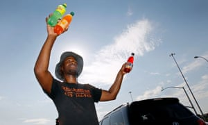 Man selling drinks to drivers in Phoenix, Arizona, 20 June 2017.