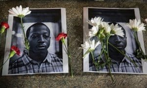 Flowers rest on top of pictures of Kalief Browder in New York on 11 June 2015.