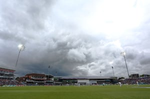 Stuart Broad starts his run up to bowl as the sun beams down and the dark clouds dissipate.