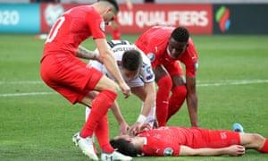 Georgia's Jano Ananidze ensures Fabian Schär's airway is open after the Switzerland defender was knocked unconscious.