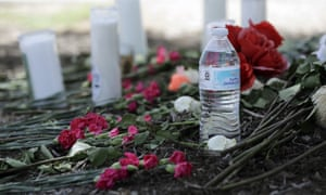 A makeshift memorial sits in the parking lot of a Walmart near the site where authorities discovered the tractor-trailer.