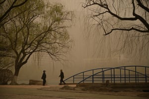 People visit a park as sandstorm hits the city of Hohhot