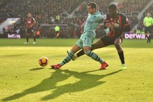 Casting shade: Arsenal's Armenian midfielder Henrikh Mkhitaryan is pressured by Bournemouth's Jefferson Lerma