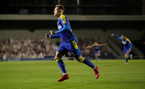 Joe Pigott celebrates in the 83rd minute after scoring his, and Wimbledon's second. However they were denied a winning start on their return to Plough Lane when Doncaster Rovers' James Coppinger equalised in added time