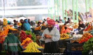 A still from Isis propaganda footage of a market in Qayyarah, Iraq