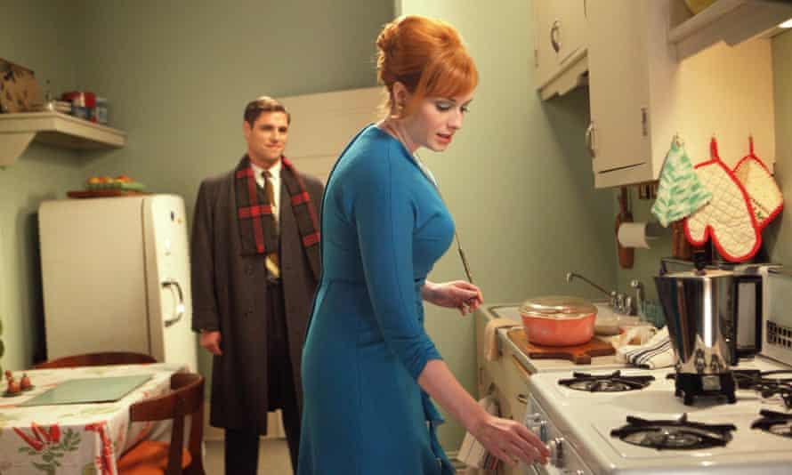 Christina Hendricks as Joan Holloway and Sam Page as Greg Harris in kitchen in an episode of Mad Men