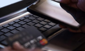 Selective focus on laptop online mobile phone payment internet banking concept in dark low key tone