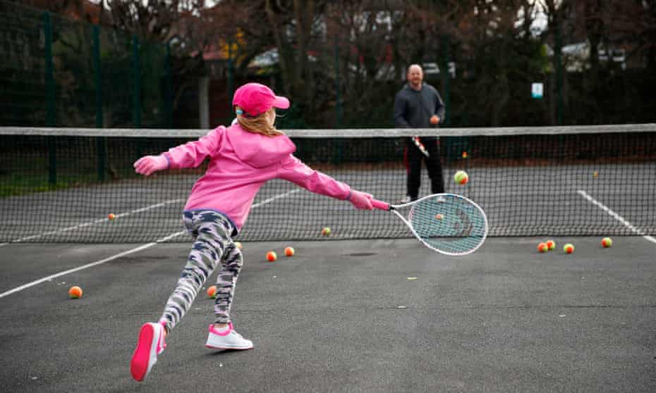 A young girl is coached.