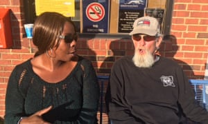 Tiffany Jones and Richard Helms at a bus stop in Gadsden.
