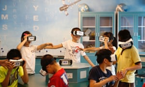 Students wear virtual reality glasses during the astronomy class in Beijing, China.