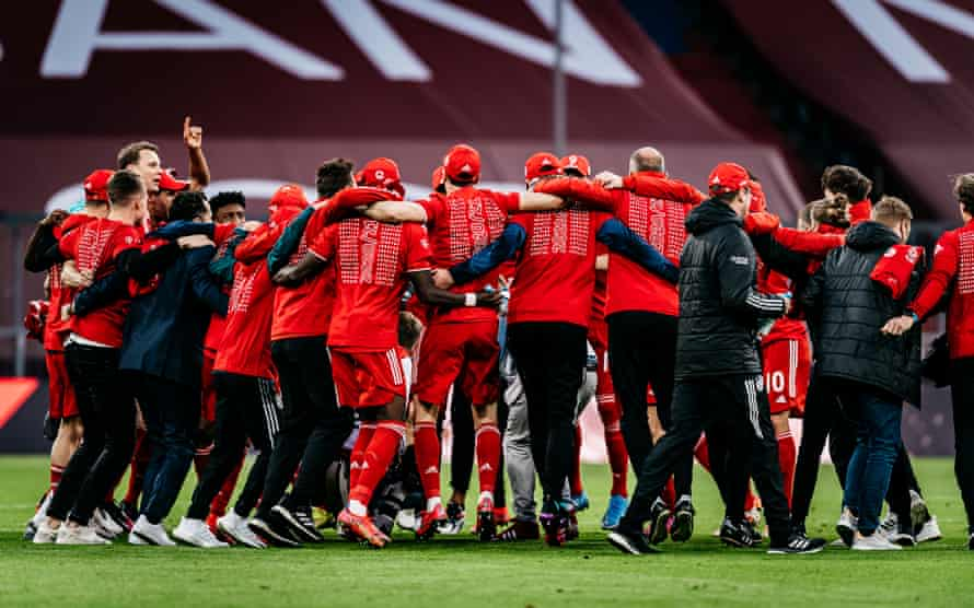Bayern players and staff celebrate at full-time.