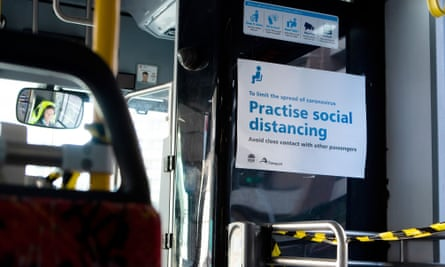 Sydney bus with social distancing sign