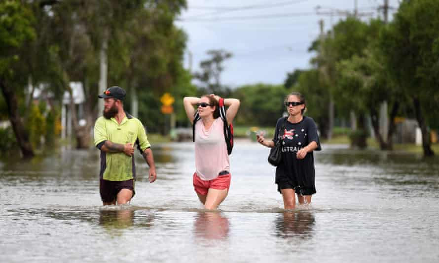 Residents wade through floodwaters