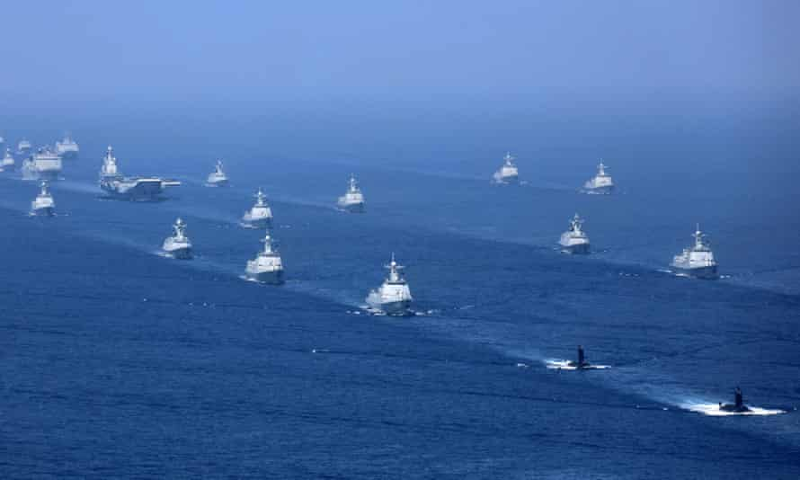 The Liaoning aircraft carrier is accompanied by navy frigates and submarines conducting an exercises around Taiwan at the northern edge of the South China Sea in 2018.