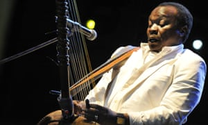 Mory Kanté plays the kora, the ancient west African harp, while performing at the Sziget festival in Budapest, 2008.