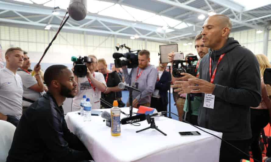 Collymore, right, speaks with Raheem Sterling during England's pre-World Cup media day at St George's Park