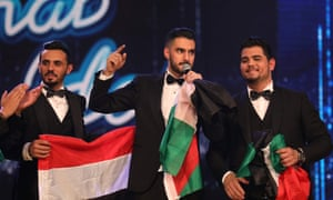 Arab Idol winner Yaqoub Shaheen, centre, with Yemeni contestant Ammar Mohammed (left) and fellow Palestinian Amir Dandan on stage during the final on Saturday.