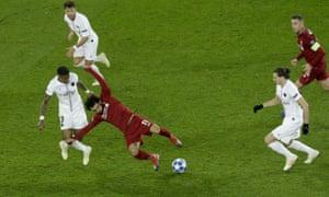 Paris Saint-Germain's Presnel Kimpembe fouls Liverpool's Mohamed Salah.