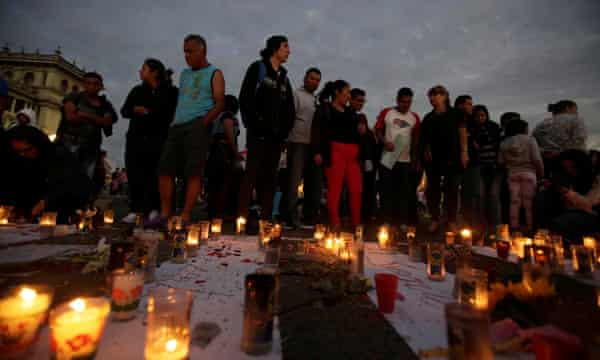 Candles are lit during a protest to demand justice for the victims of a fire at the Virgen de Asuncion children's shelter, in front of the National Palace in Guatemala City.