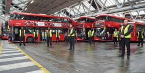 Staff inside Walworth bus depot in London observing the minute's silence in honour of key workers who have died from coronavirus.