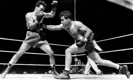 Jake LaMotta, right, fights Marcel Cerdan in Detroit in 1949. He knocked out Cerdan in the 10th round to become the world middleweight champion.