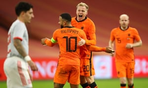 Donny van de Beek celebrates with teammate Memphis Depay after scoring Netherlands' equaliser.
