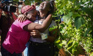 Kathryn Russell, left, cries as she is is hugged by her daughter Chrishanti Darishon, in Nassau Bahamas after arriving from Abaco, where she rode out Hurricane Dorian with her grandson, Chrishon.