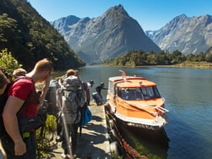 After reaching the end of the walk, a boat takes walkers out of Milford Sound.