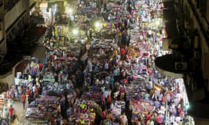 People shop at Al Ataba, a popular market in central Cairo. Street vendors have been forced out of prominent locations such as Ramses and Tahrir Squares.